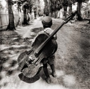 Gypsy boy with cello Hungary 1931